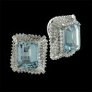 These are a very fine set of 18kt white gold Aquamarine and diamond earrings. The earrings are a clip Circa 1950's Each earring is set with one 14mm x 12mm Aqua surrounded by Approx 5.0ct of full cut diamonds and baguettes dimonds. VS F-G quality. The over all size is 21mm x 19mm.