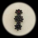 A silver garnet pin ca 1890's.  The piece measures 36mm x 14mm.