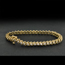 A well made 14kt gold diamond bracelet. The piece measures 7 1/2'' by 5.5mm. The bracelet is set with 43 round diamonds approx .05ct each 2.15ct tw. The diamonds are I2 H-I. The piece weighs 15 grams.