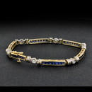 A 14kt yellow & white gold natural sapphire and diamond bracelet. The piece is set with 41 2.5mm sapphires and 6 rd .06ct diamonds. I1 H quality. The bracelet measures 7'' and weighs 14.7 grams. Nice color!