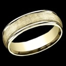 A man's Yellow Gold 6.5mm Comfort-Fit band features high polish round edges and a swirl fiberglass finish on the center. This ring is sure to bring yellow gold into style again. This mans wedding band is priced at a size 8, but can be made in other sizes. Price may vary based on size.