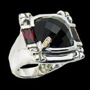 "A black onyx and rhodonite sterling silver ring. The weight of the black onyx is 8.45ctw. and  for the rhodonite it is 2.10ctw. Bellarri's signature ""B"" is made of 18K gold with 2 diamonds in the center."
