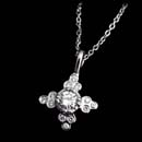 Cathy Carmendy's platinum flower pendant with .40ctw of full cut diamonds.