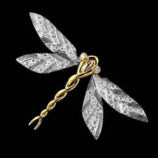 An exotic 18kt gold and platinum dragonfly pin from Michael Bondanza, set with .70ctw of diamonds.