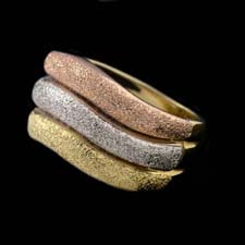 Tri-color sparkle texture ring.  This ring is made in 18kt gold amd is 8mm in width.