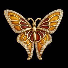 Wonderful 18kt gold enameled diamond butterfly broach from Gumuchian.  The piece is set with 1.20ct of diamonds. Pretty Pretty! 2 1/2 inches in length.