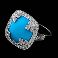 This glorious turquoise and platinum cross-shaped ring shines with .55ctw of pave diamonds.