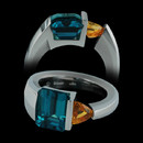 Contrasting hues: Steven Kretchmer makes use of contrast with this ladies platinum ring set with blue Indicolite tourmaline and golden sapphire.  This ring was a international awarding design and one of a kind.  We can have Kretchmer make another on a special order basis only.  Really nice!!