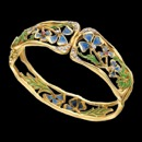 From the Art Nouveau Collection. This beautiful bracelet is made with 18kt yellow gold, blue and green enamel with 32 diamonds. The bracelet has a total diamond weight of .33ct and features two rubies. The style of the piece is art nouveau and you can not get this type of bracelet anywhere else. An incredible work of art made in Europe.
