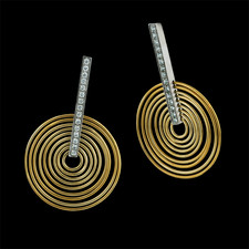 Eddie Sakamoto's beautiful spiral design.  These platinum and 18kt yellow gold earrings contain .28ct total diamond weight. With the movement in the circles, they feel amazing on.