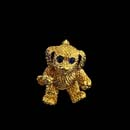 18kt. gold non-moving puppy pin with sapphire eyes. This piece measures 7/8'' in length.  Very solid piece and made in the USA