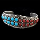 Native American Navajo silver red coral and turquoise twist wire bracelet.  The bracelet measures 16.7cm(6.5'') with a gap of 3.5cm(1.37'').