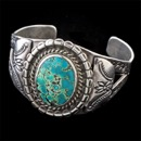 Item 025EJ4 - A great early (pre 1950) Native American Navajo turquoise hand made cuff bracelet. The larges diameter is 1 1/2 inch. The inside cuff is 2 1/4 inch.