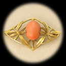 Item 029EJ5 - A fine 14kt gold angel skin coral pin from the Art Nouveau area. The coral is 15 x 11mm and the broach is 1 3/4 ' x 1 1/8'. Mint condition and all original. No repairs or stamps.  Made by hand.