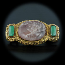 02EB7 - A unique guilt gold belt buckle from the late 19th century.  This intricately detailed piece has two jade cabochons and one large rose quartz stone in the center. The rose quartz measures approximately 42.95mm x 32.9mm. The jadeite cabochons have average measurements of 17.8mm x 9.7mm. The vintage piece is 3.25 inches in length an 1.625 inches in width. This item is in pristine condition.