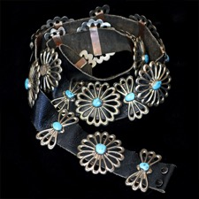 02EJ8 - A unusual Native American Navajo silver Concho belt circa 1970's. The belt measures 47'' and has 19 individual stations of butterfly (2 1/2'' x 1 3/8'') and circular (2 1/2 inch) concho's. One stone missing but over all condition very fine.   Neat piece!!