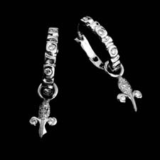 These beautiful and delicate platinum and diamond earrings are enhanced with lovely removable cross charms.