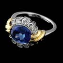 18kt yellow gold and platinum tanzanite weighing 3.40cts and diamonds weighing .72cts. ring. The finger size is 6.25.