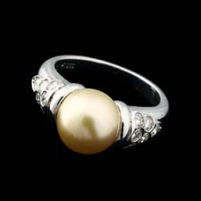 Here we have this beautiful Platinum and Diamond South Sea Golden Pearl ring. The piece contains a 9.5mm Golden South Sea Pearl with .44cts total weight in diamonds.