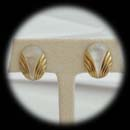 A nice deco designed mother of pearl and 14kr pierced clip earrings.  The pieces measure 18mm x 12mm.