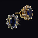 Item 033PO2 - A very nice pair of 14kt gold diamond and natural sapphire pierced earrings. The earrings measure 7.5 x 6.5mm and are set each with 10 full cut .02ct diamonds of a VS H quality. Total diamond weight .40ct. Set each are one 5mm x 3mm fine blue sapphire approx .33ct, .66ct total. Nice buy!