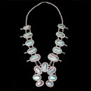 An extremely impressive Navajo silver turquoise squash blossom necklace. The over all length is 36'' and a 4'' naja. The 17 untreated natural Kingman turquoise measure from 1 to 2 inches each All handmade, old pawn, circa 1950's  This is a very large piece.