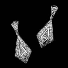 A very fine hand made set of platinum diamond drop earrings.  The earrings are set with kite shaped and round diamonds. The total diamond weight is .80ct and the quality is VVS E-F., 21.65 mm in length and 8.70mm in width from the widest point.
