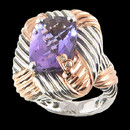 "A beautiful amethyst sterling silver and 18K gold ring from Bellarri. The amethyst has a carat weight of 6.30ctw. The head of the ring Dimensions are : 23mm x 20mm. The signature ""B"" is made of 18K gold with .01ctw. of diamonds in the center."