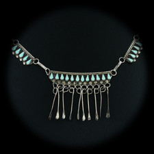 A very unique 1960's sterling silver piece with light blue turquoise. The vintage piece is in excellent condition and measures 18 �� in length. 