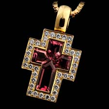 A very beautiful 18kt gold cross by Simon Lindenman. The cross is made of diamonds and pink tourmaline. The piece measures 25mm x 13mm and is suspended from a 18