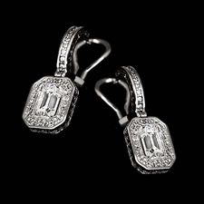 These gorgeous Alex Soldier dangling earrings shine with .68ctw in accent diamonds and are suspended with emerald-cut diamonds. Center diamonds not included. Also available in 18k white gold for $3,680.00.