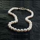 White south sea pearls with a two tone 18kt yellow gold clasp