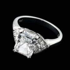 Alexander Primak platinum and diamond engagement ring with .62ctw in full-cut triangular side stones, accentuating the center stone that you desire.