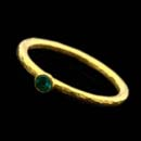 24-karat gold Gurhan stacking ring from the Skittle collection set with a 0.12ct emerald. Emerald, 0.12 ct. The ring has a platinum core. 3.0mm width.