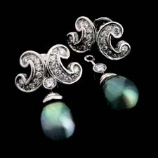 Gumuchian's Mezzalune earring.  Exquisite set of Platinum and Black pearls set with .90ct of diamonds.  The pearls detach and you can wear the diamonds by themselves.  Very classy.