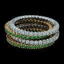Spark's stacking prong-set wedding bands in 18K yellow gold set with tsavorite garnets. The rings are priced separately. Diamond bands at 0.33 carats total weight priced at $1560.00 each. The rings measure 1.2mm in width.