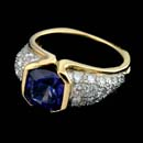 18kt yellow gold and platinum Tanzanite weighing 2.67cts and diamonds weighing 1.0cts. ring. The diamonds are VVS and E-F color and ideal cut.   This ring was made by R ichard Krementz.  Very heavy and very fine.  It is approx. 7 5mm and tapers to 3mm with Euro shank.  Great buy.