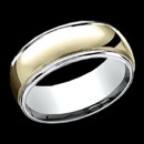 A masculine 14k gold two tone mens wedding band. This ring features 14k yellow gold in the center with 14k white gold along the edges. The ring combines classic and contemporary gold design. The price is for a size 10, but this ring can be made in other sizes. The price will vary depending on finger size.