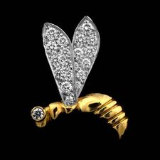 A fun 18kt gold and platinum wasp by Michael Bondanza, set with .35ct of diamonds.
