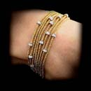Yuri 18kt yellow gold sazame bracelet with 12 rondells and .70ctw in diamonds.