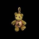 A very cute 18kt. gold baby bear with pink enameled tummy and pink sapphire eyes. Head, arms, and legs move. 7/8'' tall with gold belly. Available in 1 1/8'' for $3.450.00