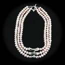 Three strand of Pink Pearl necklace with sterling silver accent tubes in the center of the piece and a sterling silver toggle clasp.