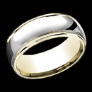 A masculine 14k gold two tone mens wedding band. This ring features 14k white gold in the center with 14k yellow gold along the edges. The ring combines classic and contemporary gold design. The price is for a size 10, but this ring can be made in other sizes. The price will vary depending on finger size.