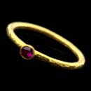 24-karat gold Gurhan stacking ring set with a 0.16 ct. ruby. The ring has a platinum core.