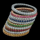 Stacking prong-set wedding bands from Spark in 18K gold set with various color stones, ruby, sapphire, or diamonds. The rings measure 1.5mm in width. Prices start at $900.00.