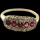 A fine 14kt gold, no stamp but tested, natural ruby and diamond ring. The ring is circa 1890's and set with 5 center round 2 1/2mm rubies. It appears that the center ruby has been replaced at some point but hay, this ring is from the Victorian era. Side filigree is moderate to fine condition. I would imagine it was worn with another band? Surrounding the rubies are 20 Old Mine cut, Old European Cut, and European cut diamonds weighing approximately .40ct +. Looks like somebody replaced lost diamonds with gems of a different era. Regardless the ring is a very pretty piece of a long passed time. 7.5mm width Size 8.