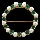 Item 06PM5 - A 14kt gold yellow gold genuine emerald and pearl circle pin circa 1970's Classic pin that can be worn in a variety of fashion looks. Great for sports coats. The pin measures 25mm in diameter and weighs 4.15 grams. Excellent condition.
