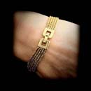Yuri 18kt yellow gold triple-braided 5 strand bracelet with a mirrored square locking clasp.