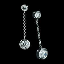 These elegant dangle 18K white gold post earrings have bezel set round diamonds with 1.40ctw, E-F color and VS2. Length is 1