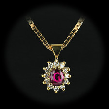 This beautiful 18kt yellow gold Gem Thai Ruby and diamond pendant containing one .66ct. natural Thai Ruby. The Ruby surrounded by 12 full cut VS F ideal cut diamonds 1/3ct total total weight in diamonds.  The piece is suspended on an 18 inch 18kt yellow gold Italian made box chain.